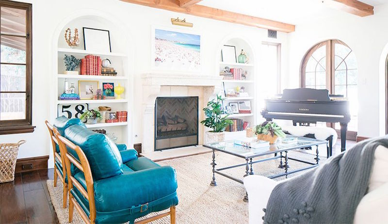 built in bookshelves arched bookshelves grand piano teal chair