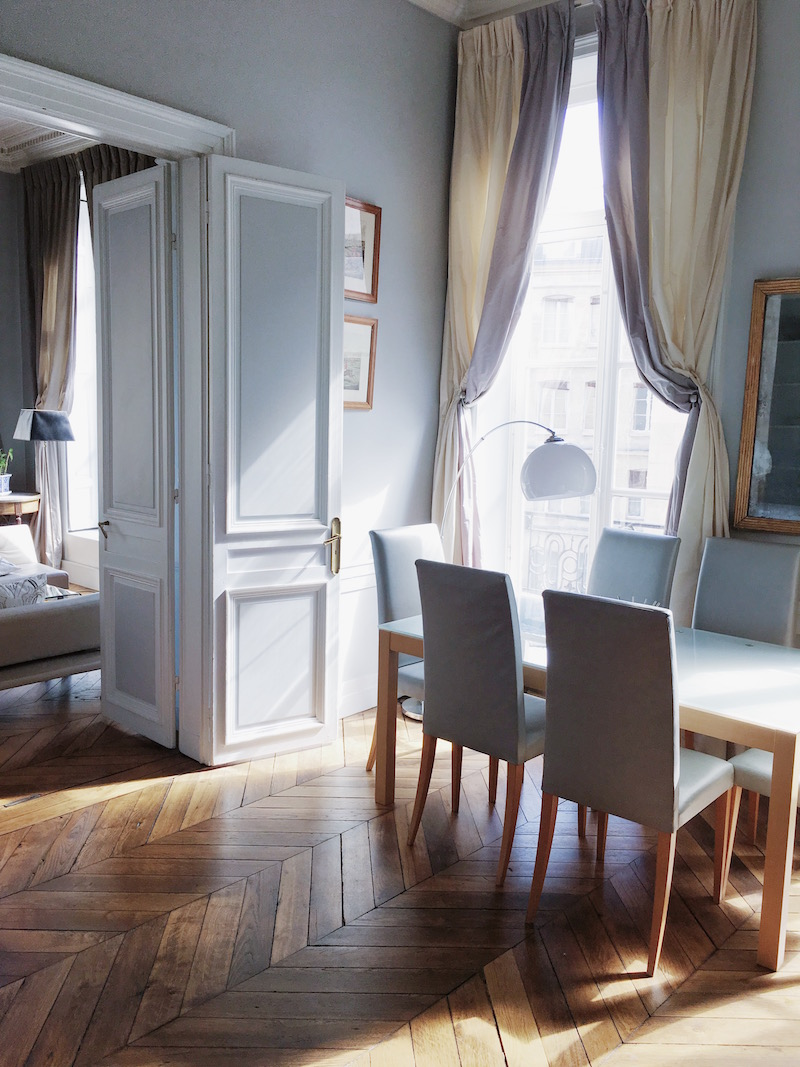 paris dining room drapery chevron floors table chairs white grey walls