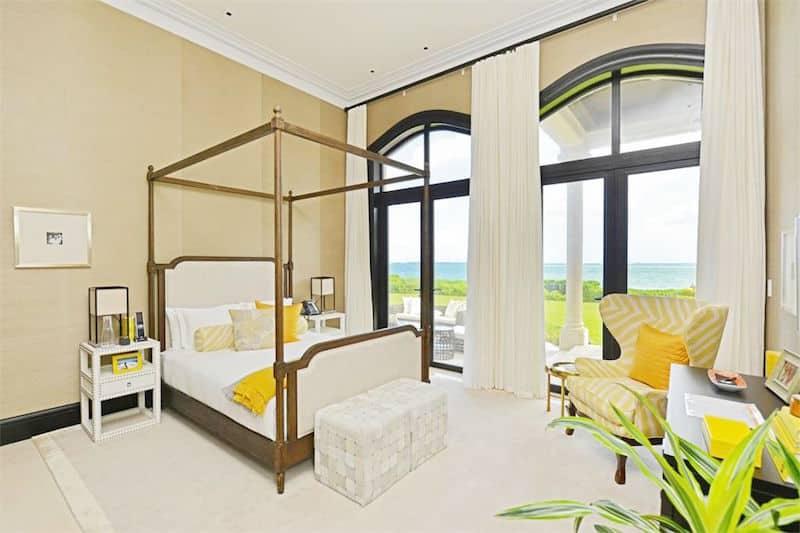 casa sophia bahamas guest bedoom yellow canopy bed