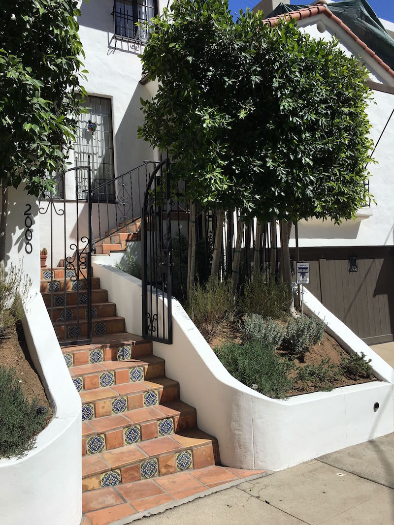 hollywood hills house tour debra messing exterior tile stairs