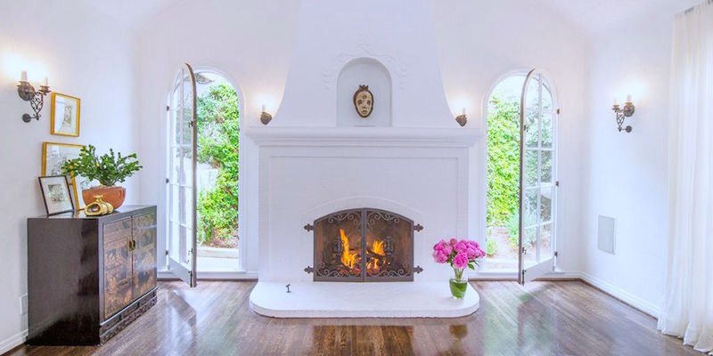 hollywood hills house tour debra messing fireplace living room