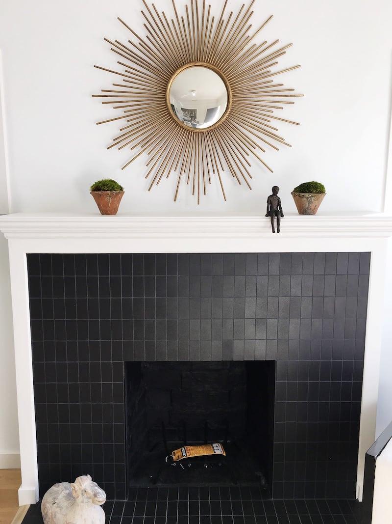 venice cottage fireplace sunburst gold mirror black tile fireplace
