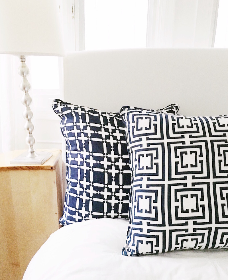bedside table style navy logo plaid pillows
