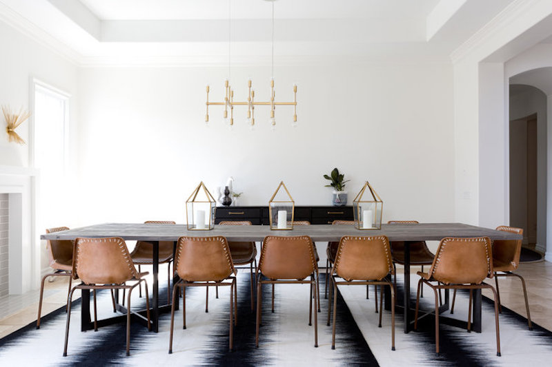 california home remodel dining room after white walls gold chandelier leather chairs striped rug