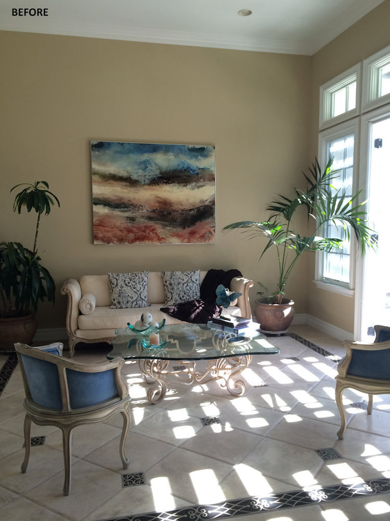 california home redesign living room before dark walls cream couch blue chairs
