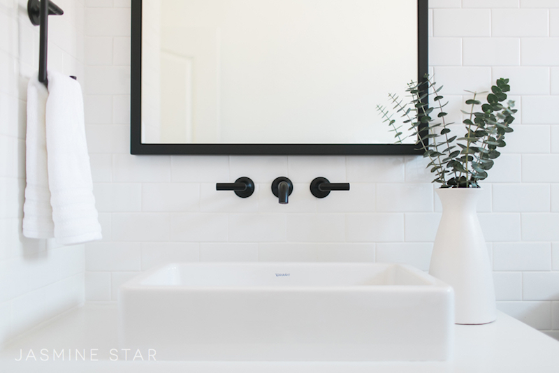 white sink black faucet