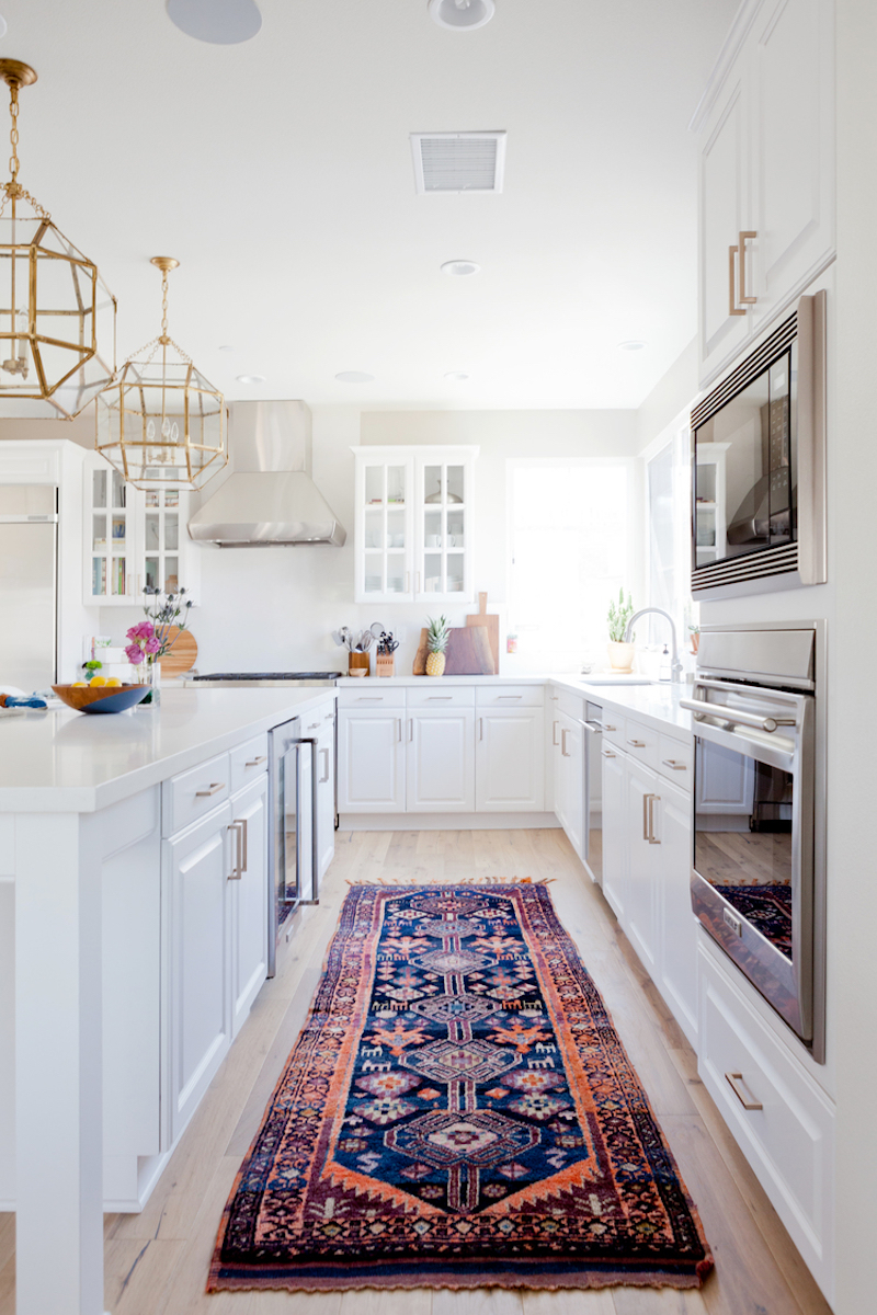 bright white kitchen rug gold light fixture