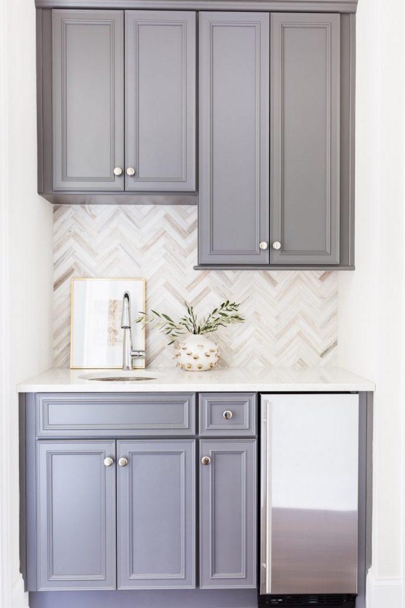 classic white kitchen herringbone backsplash grey cabinets
