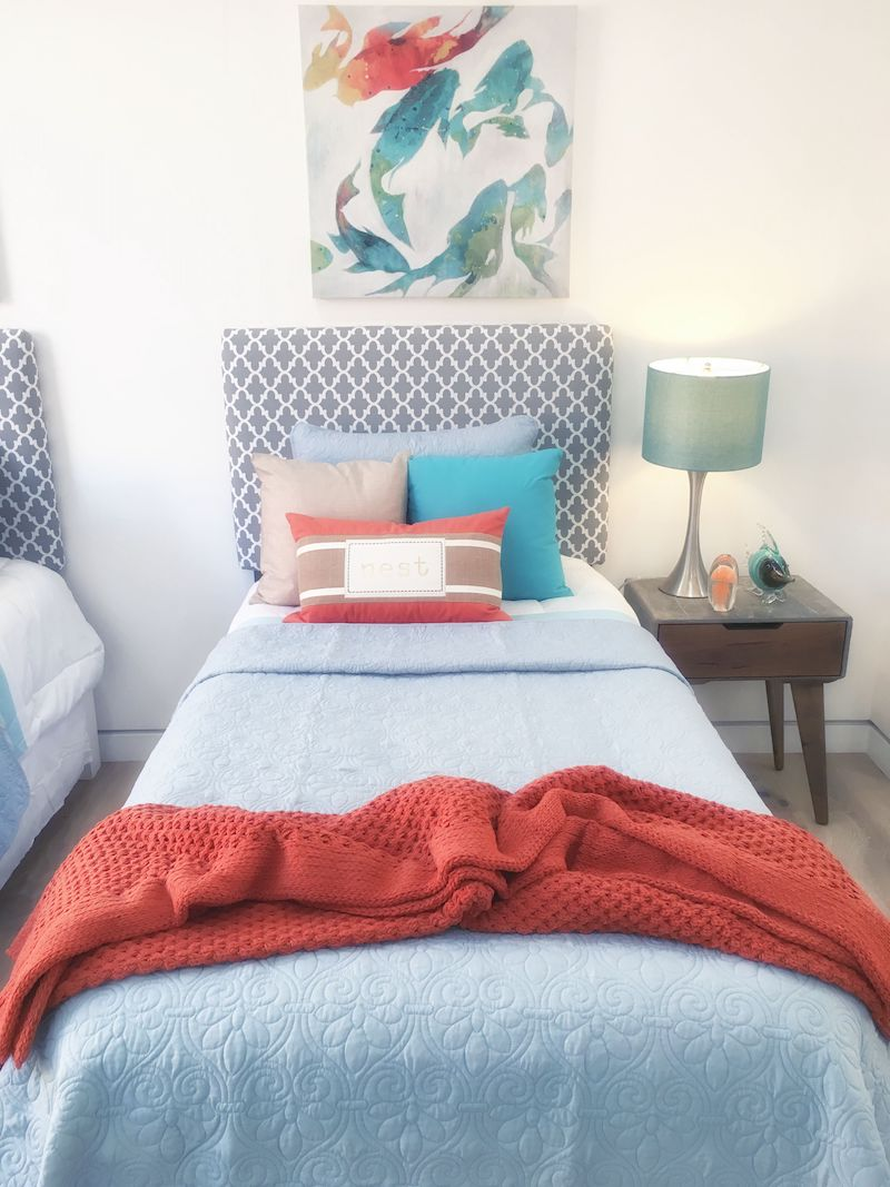 two-twin-bedrooms-blue-red-blanket-rug