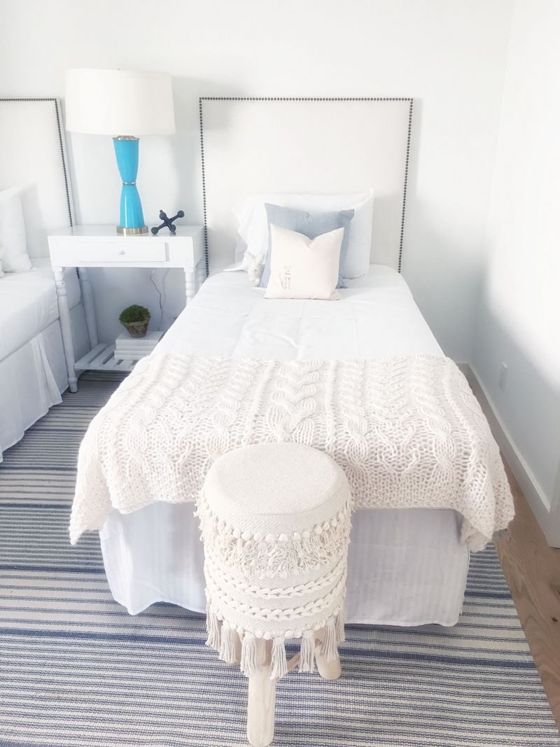 two-twin-bedrooms-cream-blue-bed-stool