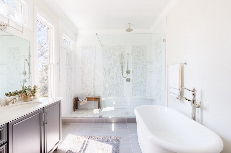 white marble mosaic bathroom footed tub natural light