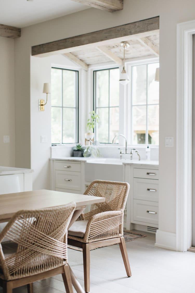 white-modern-open-kitchen-marble-sink-slab-backsplash-woven-dining ...