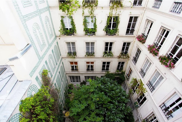 View of a secret courtyard from a pied-a-terre apartment in Paris, France