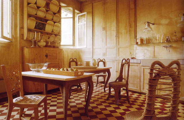 Rustic kitchen with checkerboard tile floor, wood cabinets, a table with rope legs and rope chairs
