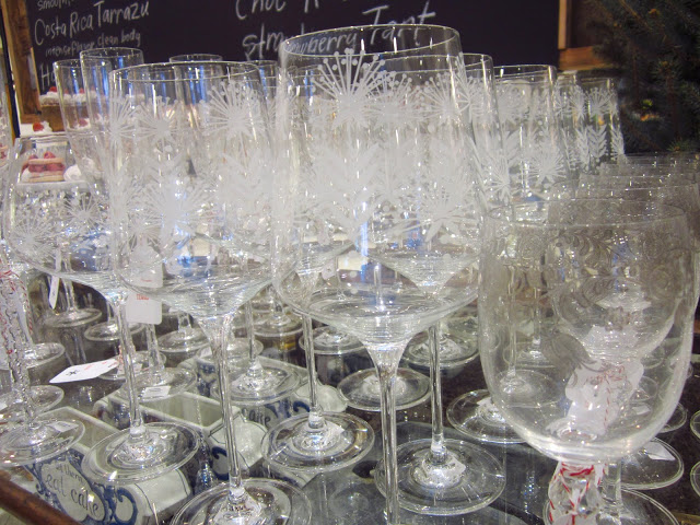 Rows of etched stemwear glass on a glass table
