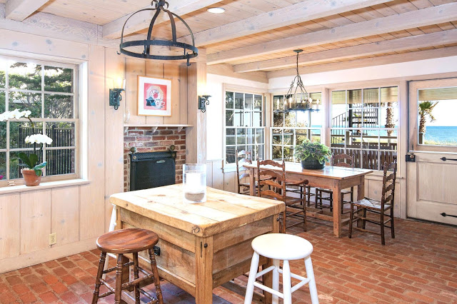 country eat in kitchen brick floors rustic island ocean water view