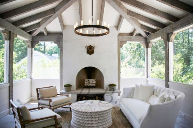 Covered outdoor patio with curved white sofa