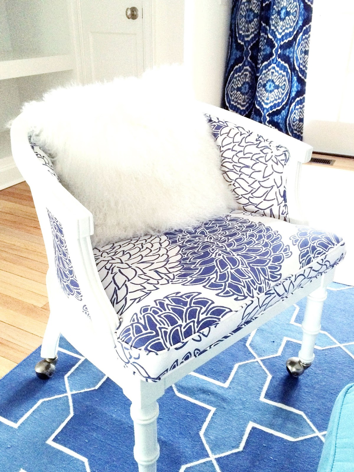 vintage chair in a blue and white east hampton living room - Living Room East Hampton