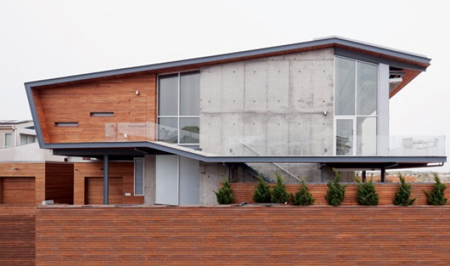 exterior of the house raised on platform with retractable wall closed