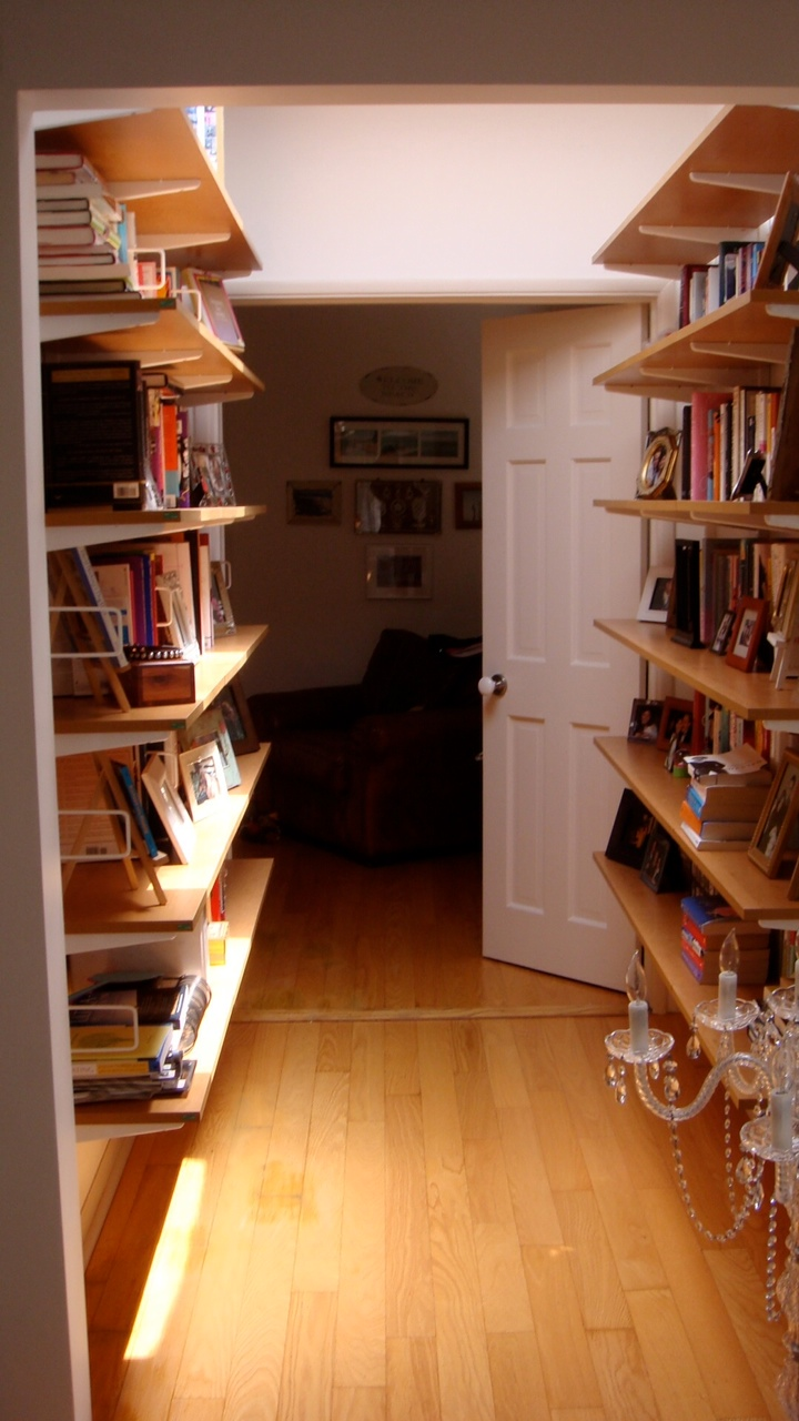 Before JLF Used Honey Colored Open Shelving To Create A Hallway Library The Space Was Functional Above