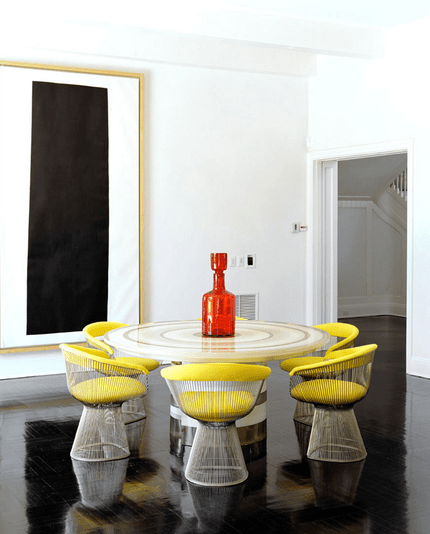 Dining room with Platner chairs with yellow cushions