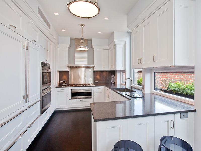 the white kitchen in an apartment has white cabinet and drawers with long drawer pulls black white home office cococozy 5