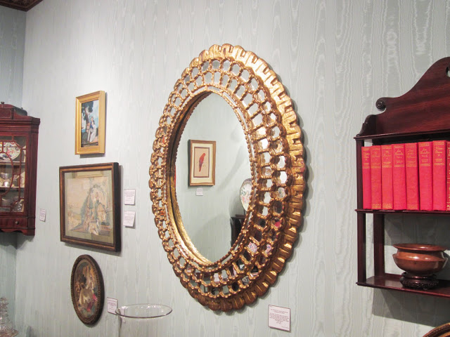 Antique round Peruvian gilt wood mirror