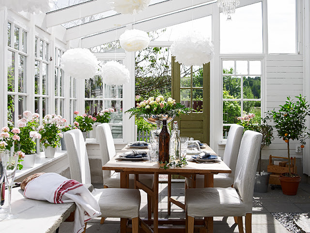 Atrium dining room glass ceiling and windows cottage white reclaimed wood table