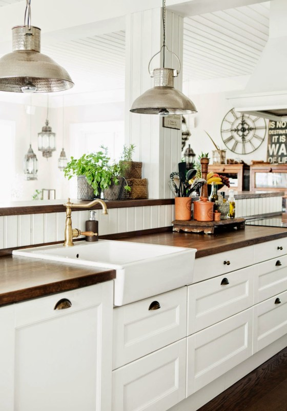 Classic farm style kitchen with butcher block wood counters in a Swedish home