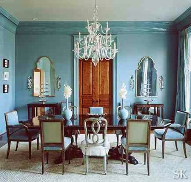 Blue dining room with mismatched chairs