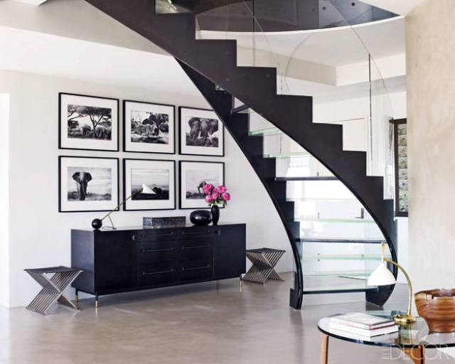 glass stairs black railing design decor gallery wall black white photo photography new york city apartment
