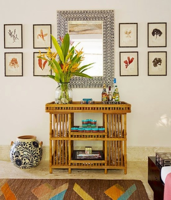Bamboo side table and graphic mirror in a home by Juan Montoya