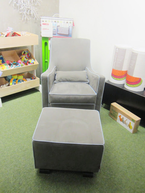 Grey glider ottoman style rocking chair with light blue piping