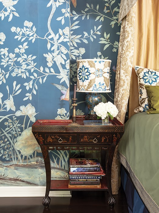 Bedroom with foliage wallpaper, floral lampshades and a hydrangea on a vintage nightstand