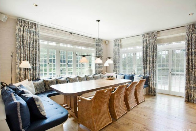 informal dining room with banquette seating, wicker chairs, french doors and windows, wood floor and pendant style chandelier