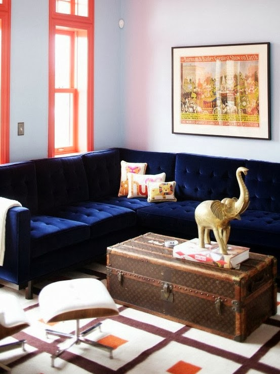 Living room with a Louis Vuitton trunk doubling as coffee table and  blue velvet LOUIS VUITTON TRUNKS TRANSFORMED COCOCOZY