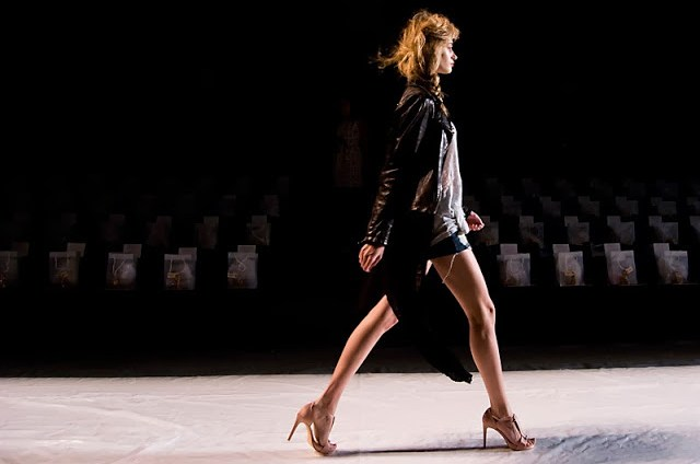 Model on runway during a fashion show dress rehearsal