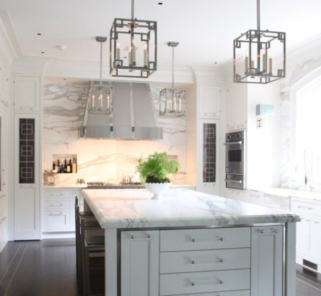 Silver Kitchen Grey Cabinets Carara Marble Countertops And The Marble Slab Backsplash Make For A Kitchen That Shimmers Above