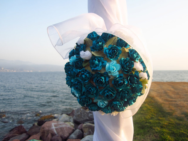 floral pom pom attached to a fabric wrapped arch