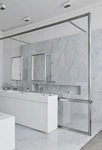 Marble shower behind a glass wall
