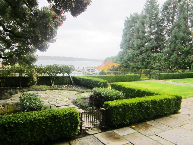 Grounds at a Lake Washington estate with a view of the lake on a cloudy day