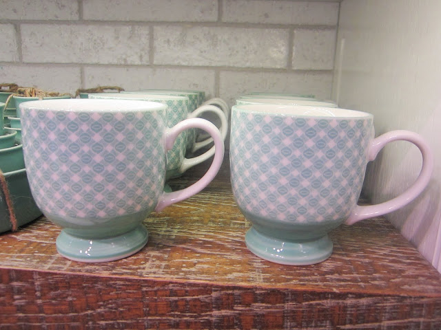 Two rows of blue and white modernist mugs