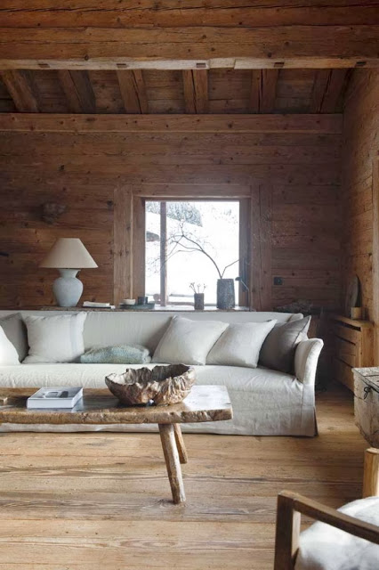 Fully wood paneled mountain house with a window seat