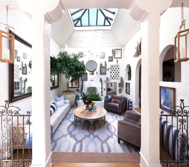 eclectic living room with skylight and lots of mirrors