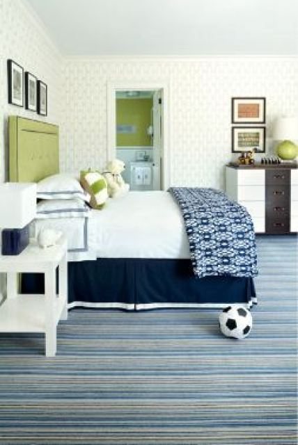 Boys bedroom with lime green upholstered headboard, striped carpet and white and wood chest of drawers