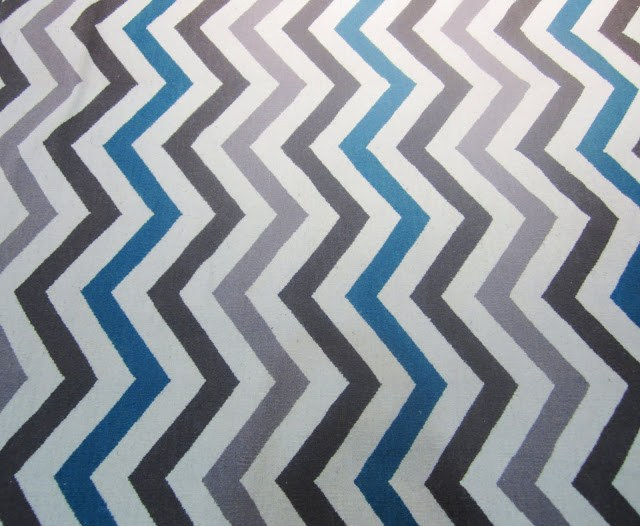 multicolored brown, blue and taupe chevron rug by Dwell Studio