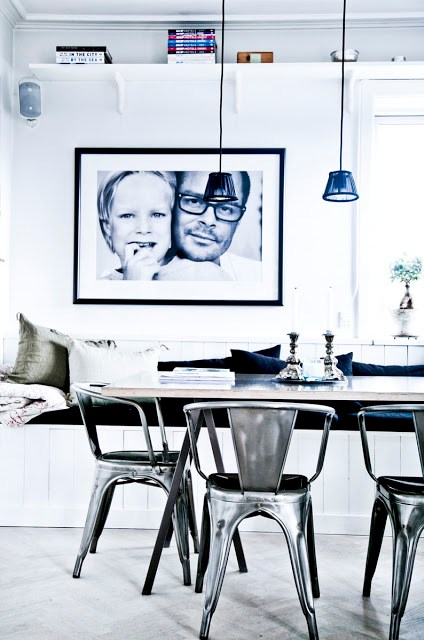 White modern dining room silver cafe chairs blue glass pendant lights light herringbone wood floor