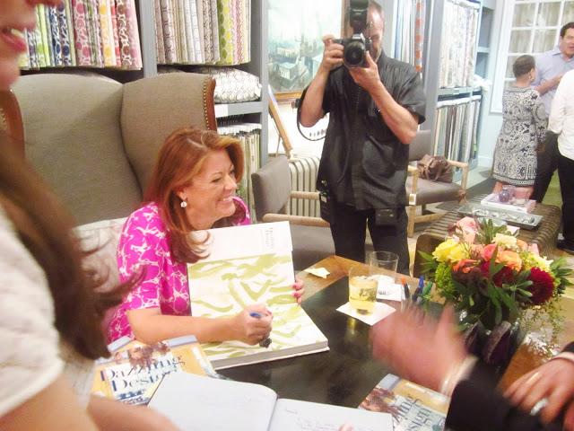 Amanda Nisbet signing copies of her book