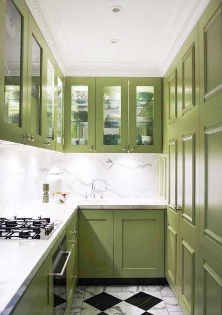small gallery kitchen galley kitchen with avocado green cabinets, a marble slab backsplash and marble checkered tile floors