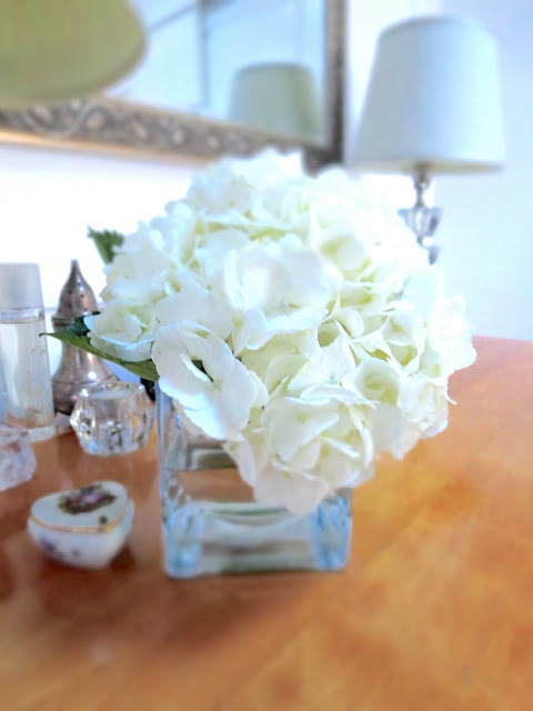 white hydrangea on COCOCOZY bedroom dresser flowers mirror lamp